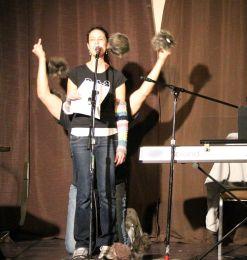 Debs, of DebsandErrol, attempts to sing Tribbles while Errol attempts to throw every Tribble at her