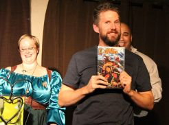Devin Melanson (Copy Red Leader) picks up a copy of Red Squirrel from Poorman Comics