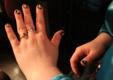 The engagement rings. She said yes a thousand times. He owes 998 more rings.