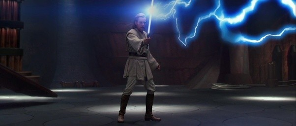 Young Obi Wan blocks a bolt of force lightning with his lightsaber